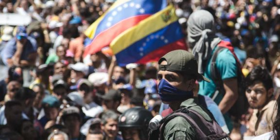 Soldier wearing blue bandana supports Juan Guaido