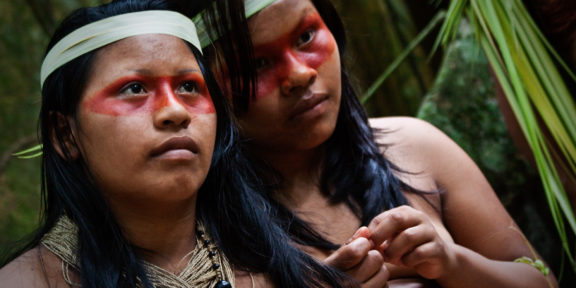 Indigenous Waorani girls in the Amazon Rainforest.