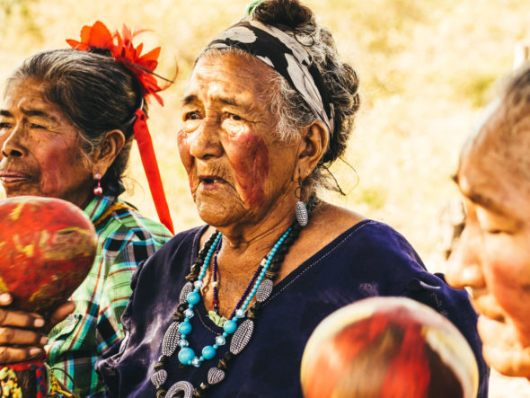 Indigenous women in Paraguay singing and protesting