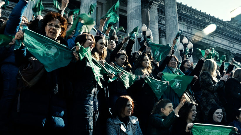 Protestors for legal abortion with green handkerchiefs