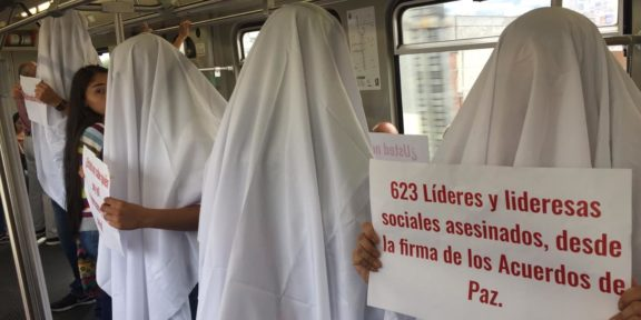 Demonstrators in white sheets are protesting the killings of social leaders in Colombia