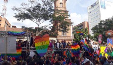 Medellin Pride parade float crowd flag