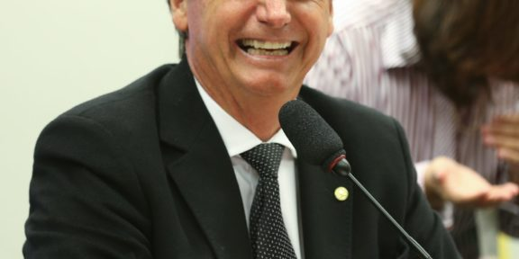 Jair Bolsonaro smiling
