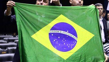Jair Bolsonaro and Eduardo Bolsonaro with Brazilian Flag