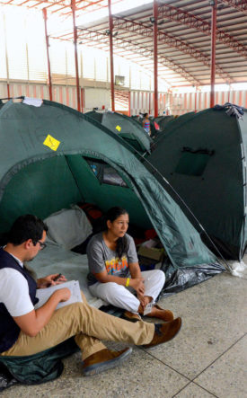 Venezuelan Woman in tent with child