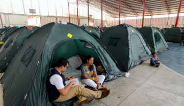 Venezuelan Woman in tent with child