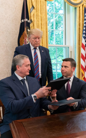 U.S. President Trump observes as Kevin McAleenan and Enrique Antonio Degenhart Asturias, Guatemala's Minister of Interior and Home Affairs sign 'Third-country asylum rule'