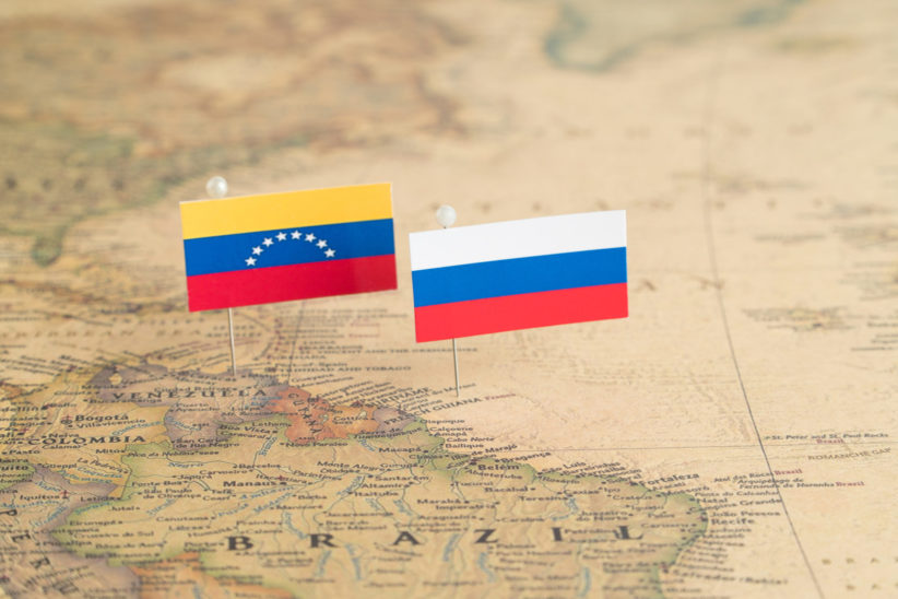 Venezuela and Russian flags on a map